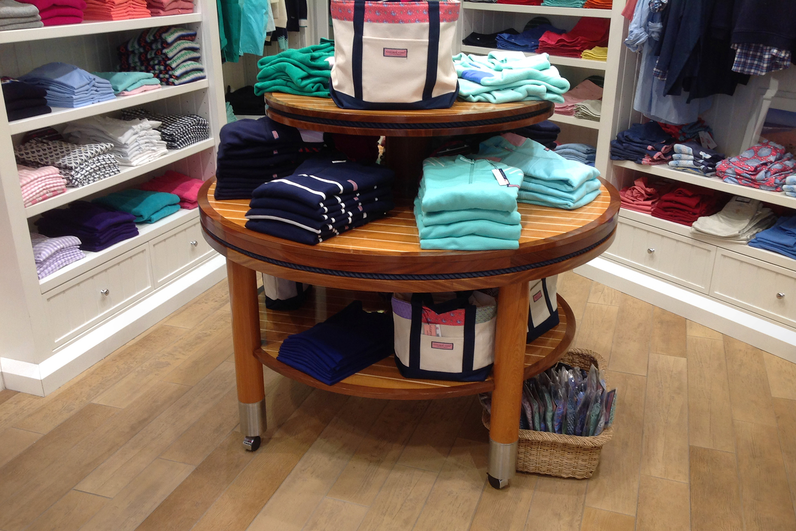 Focus on rolling table displaying apparel.