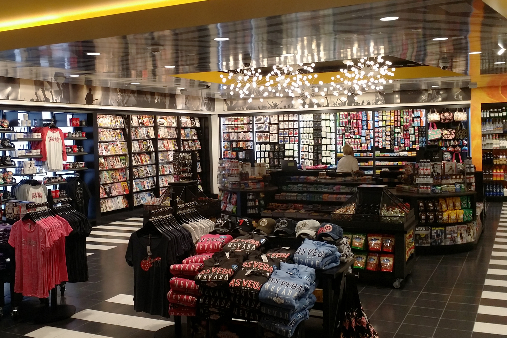 Wide shot of apparel in the foreground and wall retail fixtures in the background