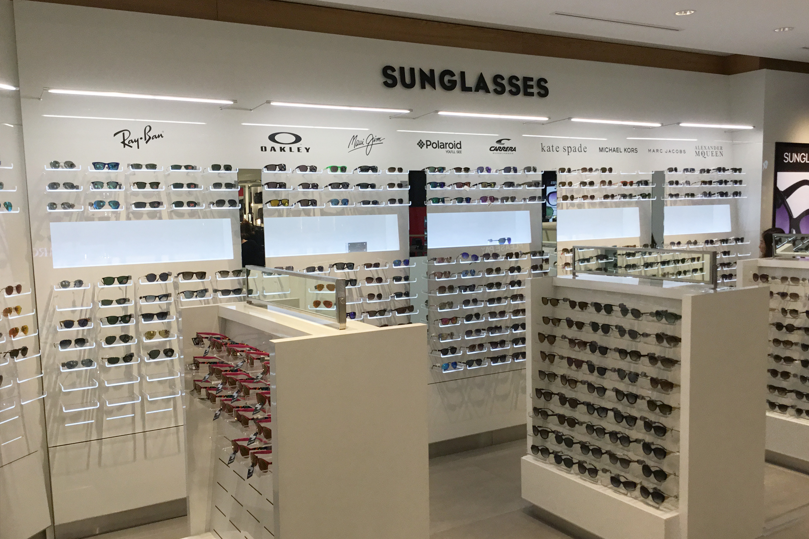 High end retail sunglass wall.