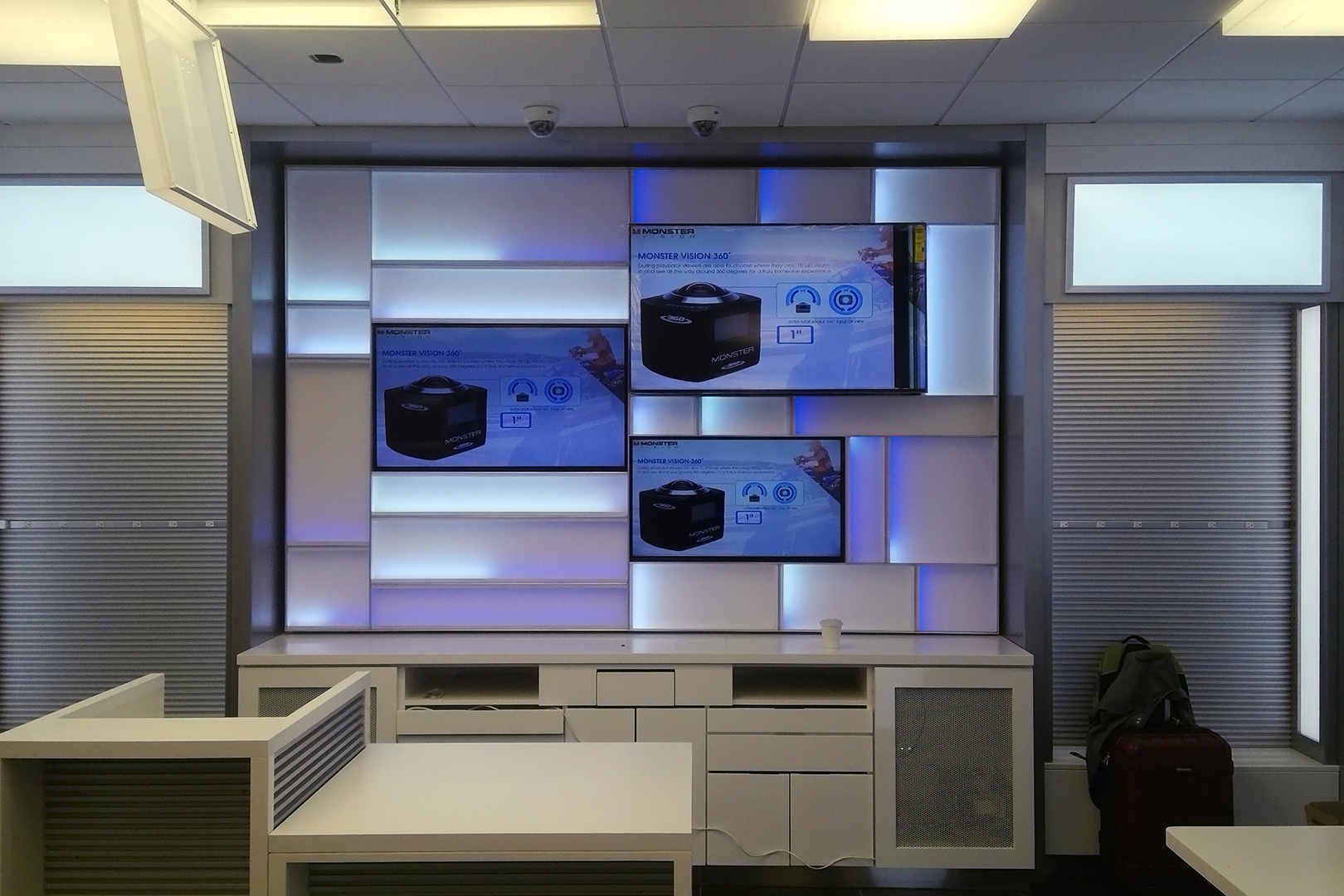 Tech on the go backlit wall fixtures and video screens.