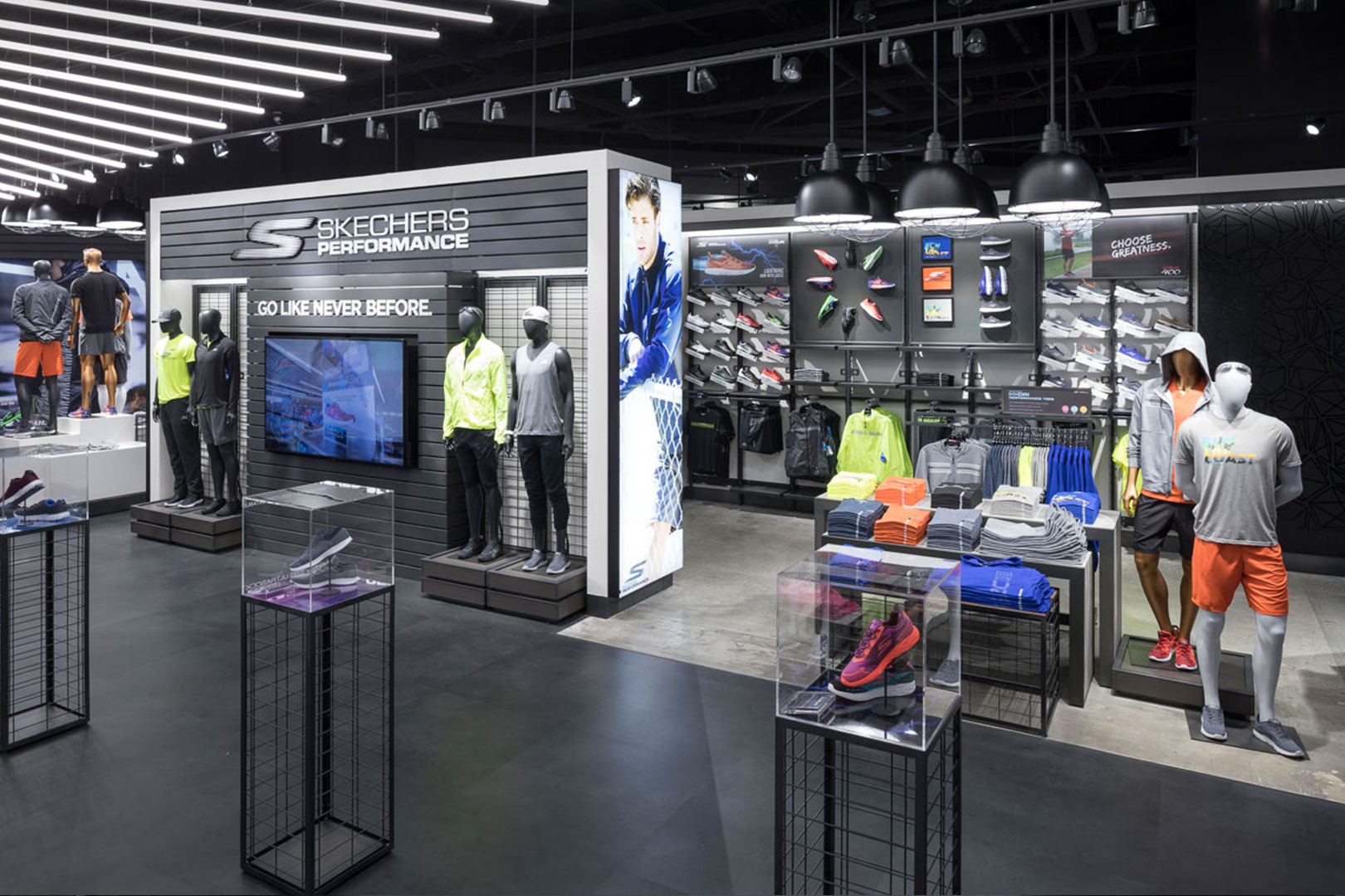 Skechers athletic apparel displays freestanding and slat wall